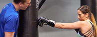 woman striking punching bag