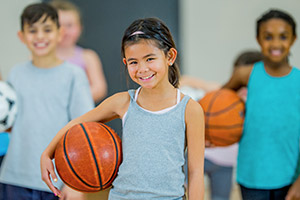 Image of young girl with basketball