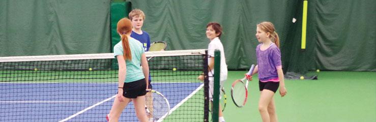 kids playing tennis at junior tennis camp